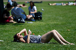 © Licensed to London News Pictures. 19/07/2016. London, UK. People sunbathe as they enjoy the hottest day of the year so far in the UK in St James's Park in London on Tuesday, 19 July 2016. Photo credit: Tolga Akmen/LNP