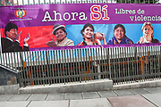 Bolivia 2013. La Paz. Banner celebrating Law against sexual violence, saying in Spanish Ahora si, Libres de violencia ( Now we are free of violence) with photographs of a variety of smiling women and President Morales.
