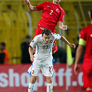 Turkey's Semih Kaya (B) and Czech Republic's David Lafata (F) during their UEFA Euro 2016 qualification Group A soccer match Turkey betwen Czech Republic at Sukru Saracoglu stadium in Istanbul October 10, 2014. Photo by Aykut AKICI/TURKPIX