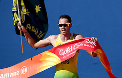 Australia's Jacob Birtwhistle crosses the finish line to take gold during the Mixed Team Relay Triathlon final at the Southport Broadwater Parklands during day three of the 2018 Commonwealth Games in the Gold Coast, Australia.