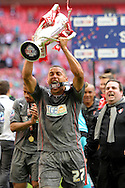 Rotherham United's James Tavernier celebrates lifting League One Playoff Trophy. Skybet football league one play off final match , Leyton Orient  v Rotherham Utd at Wembley Stadium in  London on Sunday 25th May 2014.<br /> pic by John Patrick Fletcher, Andrew Orchard sports photography.