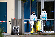 Cleaning crews wearing full PPE stand outside the the Sutton Street complex amid the third full day of the total lockdown of 9 housing commission high rise towers in North Melbourne and Flemington during COVID 19.After recording 191 COVID-19 cases overnight forcing Premier Daniel Andrews to announce today that all of metropolitan Melbourne along with one regional centre, Mitchell Shire will once more go back to stage three lockdowns from midnight Wednesday June 8. This comes as the residents of the housing commission towers in North Melbourne and Flemington finish their third day under extreme lockdown, despite only 27 cases being found in the towers. Members of the public gathered outside of the towers this afternoon in support of those trapped inside while riot police arrested two women for standing too close to the fence. While the women were later released, tensions are boiling over both in the towers and out. With 772 active cases in Victoria, NSW closed their border to Victoria effective at midnight tonight.