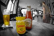 Close up of Mustard & ketchup bottles- Pub - Lonodon - UK