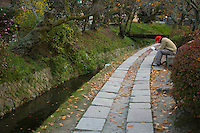 Philosophers Path; Ikutaro Nishida and Hajime Kawakami, former professors at Kyoto University, used to walk along Tetsugaku-no-Michi, or Path of Philosophy in meditation - thus its name. This two-kilometer path which follows a canal, runs from Ginkaku - ji Temple to Wakaoji-Shrine. Cherry and maple trees line the small canal forming a tunnel of cherry blossoms in the spring and colorful maple leaves in the fall.