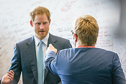 """21 July 2016, Durban, South Africa: Sir Elton John points at Prince Harry as they meet by the """"Pro Test"""" wall at the 2016 International AIDS Conference in Durban, South Africa."""