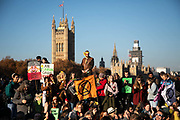 Thousands of Extinction Rebellion activists took over 5 bridges in Central London and blocked them for the day, November 17 2018, Central London, United Kingdom. Lambeth Bridge; Around 11am people on all bridges sat down in the road and blocked traffic from coming through and stayed till late afternoon. The actvists believe that the government is not doing enough to avoid catastrophic climate change and they demand the government take radical action to save future generations and the planet. Many are willing to be arrested peacefully protesting and up to 80 were arrested on the day. Extinction Rebellion is a grass root climate change group started in 2018 and has gained a huge following of people commited to peaceful protests and who ready to be arrested. Their major concern is that the world is facing catastropohic climate change and they want the British government to act now to save future generations.
