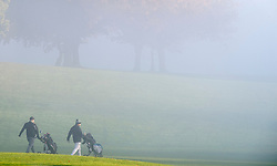©Licensed to London News Pictures 09/11/2019.<br /> Orpington,UK. Two golfers starting their round of golf. A cold and misty landscape this morning across Cray Valley golf club, Orpington, South East London. Photo credit: Grant Falvey/LNP