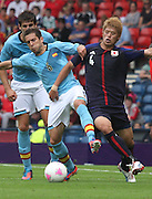 Men's Olympic Football match Spain v Japan on 26.7.12...Jordi Alba of Spain and Hiroki Sakai of Japan, during the Spain v Japan Men's Olympic Football match at Hampden Park, Glasgow...Picture John Millar / ProLens PhotoAgency / PLPA.Thursday 26th July 2012......................