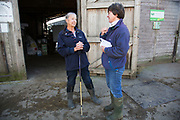 Sally Banks chatting with her husband John Banks mother Angela. The farm has been in the family since the 1930s. Wildon Grange Dairy Farm, Coxwold, North Yorkshire, UK. Owned and run by the Banks family, dairy farming here is a scientific business, where nothing is left to chance. From the breeding, nutrition and health of their closed stock of Holstein Friesian cows, through to the end product, the team here work tirelessly, around to clock to ensure content and healthy animals, and excellent quality milk.