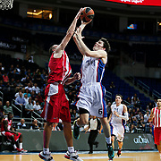 Anadolu Efes's Cedi Osman (R) during their Gloria Cup Basketball Tournament match Anadolu Efes between Olympiacos at Ulker Sports Arena in istanbul Turkey on Tuesday 23 September 2014. Photo by Aykut AKICI/TURKPIX
