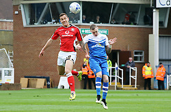 Peterborough United's Marcus Maddison jumps for the ball with Walsall's Kieron Morris - Photo mandatory by-line: Joe Dent/JMP - Mobile: 07966 386802 - 06/04/2015 - SPORT - Football - Peterborough - ABAX Stadium - Peterborough United v Walsall - Sky Bet League One