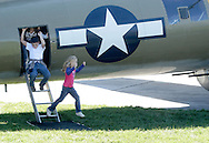 Montgomery, New York - Children climb out of a B-17 Flying Fortress bomber at Orange County Airport on Oct. 2, 2010. Three World War II planes from the Collings Foundation wereon display and available for tours and flights at Orange County Airport on Oct. 2, 2010.
