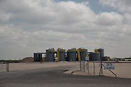 A salt water disposal site, in the Permian Basin in West Texas.  Salt water disposal wells have been blamed for air and water pollution and  earthquakes.  The industry sites are used to inject  'produced' water collected after a frack job and inject it into deep wells.