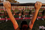 Female recruits struggle to bring their knees upward as they hang from a bar during one of the many stations in the physical fitness section of their training.  Marine Corps Recruit Depot at Parris Island in South Carolina is where all male recruits living east of the Mississippi River and all female recruits from all over the US receive their arduous twelve week training in their quest to become marines. Even though there are two current active wars and a weak economy, recruitment has not been effected.  Actually, recruiting numbers have increased, with more young men and women looking toward the military for answers.