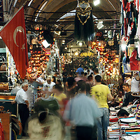 Istanbul , Turkey 06 July 2005<br /> Grand Bazaar of Istanbul.<br /> The Grand Bazaar (or Covered Bazaar) in Istanbul is one of the largest covered markets in the world with more than 58 streets and 4,000 shops, and has between 250,000 and 400,000 visitors daily. <br /> It is well known for its jewelry, pottery, spice, and carpet shops. <br /> The bazaar contains two domed masonry structures built for storage and safe keeping, the first of which was constructed between 1455 and 1461 by the order of Sultan Mehmed the Conqueror. <br /> The bazaar was vastly enlarged in the 16th century, during the reign of Sultan Suleiman the Magnificent, and in 1894 underwent a major restoration following an earthquake.<br /> Photo: Ezequiel Scagnetti