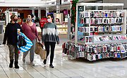 Shoppers (from left) Lindsey Middendorf and Tammy Heinecke, both from New Athens, and Abby Guyette from Freeburg walk towards an exit at St. Clair Square mall in Fairview Heights after shopping for deals on clothing on Friday November 27, 2020. Heinecke and Guyette are sisters.<br /> Photo by Tim Vizer