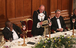 South African President Cyril Ramaphosa (left) and Chancellor of the Exchequer Philip Hammond (right) listen as the Lord Mayor of the City of London, Charles Bowman delivers a speech at the Commonwealth Heads of Government banquet at the Guildhall in London, during the Commonwealth Heads of Government Meeting biennial summit.