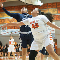 Piedra Vista's Lanae Billy (32) drives to the basket for a layup as Gallup's Hailey Long (40) defends Saturday, Dec. 7 at the John Lomasney 45th annual Gallup Girls Invitational Basketball Tournament championship game in Gallup.