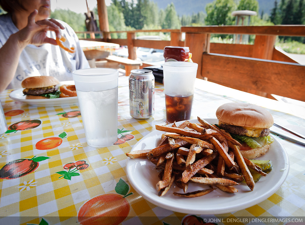 Burgers and french fries are a popular menu items at the 33 Mile Roadhouse located on the scenic Haines Highway (Alaska Highway 7) near the Canadian border. The restaurant and gas station is popular with tourists, heli-skiers and local residents. The original roadhouse building was built during the 1930's but later was destroyed in a fire in 1984. The current structure on the original site was built and open for business nine months later. 33 Mile Roadhouse is just up from banks of the Klehini River and near the Porcupine Creek gold mining area.