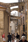 Houses stabilized with arches at Bonifacio's Ville Haute atop the chalky limestone cliffs.