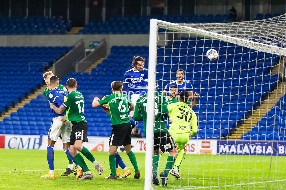 GOAL £3-2 Cardiff City's Sean Morrison (4) scores his side's third goal during the EFL Sky Bet Championship match between Cardiff City and Birmingham City at the Cardiff City Stadium, Cardiff, Wales on 16 December 2020.