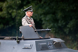 Reenactor dressed as a German Hauptman riding an Sd.Kfz 251 <br /> Sheffield Fair at Norfolk Heritage Park Sheffield Bank Holiday Weekend.<br /> 28th & 29th August 2011  <br /> Image © Paul David Drabble