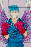 Mural of a nurse battling the COVID-19 pandemic (by artist Austin-Zucchini Fowler), Denver, Colorado USA.