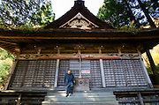 Yoshifumi Yamada, 84, chairman of Lake Shouji Touism Association, descends the steps after saying a prayer at a shrine at the entrance of a cemetery in which the remains of unidentifiable suicide victims are interred  near Aokigahara Jukai, better known as the Mt. Fuji suicide forest, which is located at the base of Japan's famed mountain west of Tokyo, Japan on 03 Nov. 2009. The local community built a hall nearby especially for suicide victims to be interred.