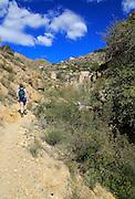 Woman walking Ruta del Agua to Huebro, <br /> Sierra Alhamilla mountains, Nijar, Almeria, Spain