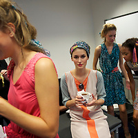 Models take a tea break backstage during the Saloni autumn/spring 2010/2011 show held in the map room of the Royal Geographical Society, South Kensington, London on 20 September 2010.