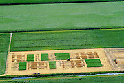 Nederland, Drenthe, Valthermond, 05-08-2014; graanoogst op proefvelden voor gewassen in de veenkolonien. <br /> Grain harvest in a peat landscape, East Netherlands (near German border). Test fields for crops.<br /> luchtfoto (toeslag op standard tarieven);<br /> aerial photo (additional fee required);<br /> copyright foto/photo Siebe Swart