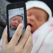 A mother takes a iPhone picture of her newborn baby while asleep. Photo Tim Clayton