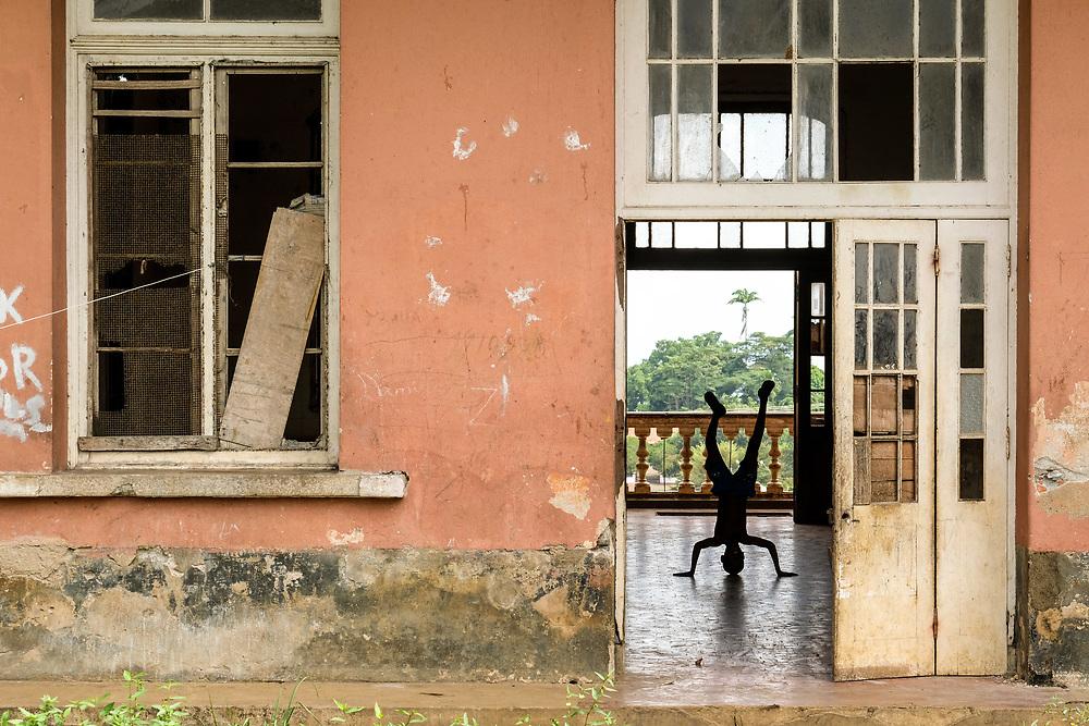 Boys showing around Roça Agostinho Neto (Agostinho Neto farm) in São Tomé island.