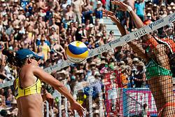 Juliana Felisberta Silva of Brazil blocks Vivian Danielle da Conceicao Cunha of Brazil shot at A1 Beach Volleyball Grand Slam tournament of Swatch FIVB World Tour 2010, final, on July 31, 2010 in Klagenfurt, Austria. (Photo by Matic Klansek Velej / Sportida)