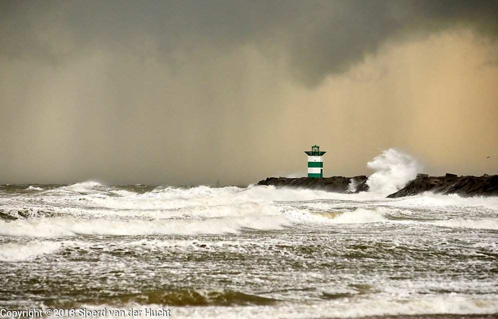View on a breaker and pier during a stormy day at the  coast of The Hague, Netherlands