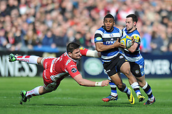 Kyle Eastmond (Bath) takes on the Gloucester defence - Photo mandatory by-line: Patrick Khachfe/JMP - Tel: Mobile: 07966 386802 12/04/2014 - SPORT - RUGBY UNION - Kingsholm Stadium, Gloucester - Gloucester Rugby v Bath Rugby - Aviva Premiership.