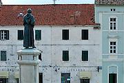 Rear view of Statue of friar Andrija Kacic-Miosic, in town square Kacicev trg. Makarska, Croatia