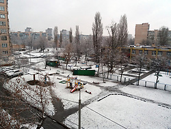 March 27, 2019 - Kyiv, Ukraine - Snow covers a playground in the yard of a block of flats, Kyiv, capital of Ukraine, March 27, 2019. Ukrinform. (Credit Image: © Inna Borodaieva/Ukrinform via ZUMA Wire)