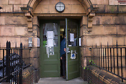 A Lambeth council man closes the doors behind court officials at Carnegie Library in Herne Hill, south London to serve an eviction notice while occupiers remain inside the premises on day 9 of its occupation, 8th April 2016. The angry local community in the south London borough have occupied their important resource for learning and social hub for the weekend. After a long campaign by locals, Lambeth have gone ahead and closed the library's doors for the last time because they say, cuts to their budget mean millions must be saved.