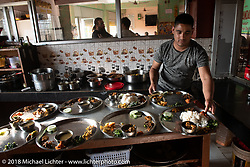 Another wonderful Nepalese rice thali lunch (a generous individual platter with all 6 different flavors of sweet, salt, bitter, sour, astringent and spicy) at an impromptu stop at a restaurant in Kushma on day-7 of our Himalayan Heroes adventure riding from Tatopani to Pokhara, Nepal. Monday, November 12, 2018. Photography ©2018 Michael Lichter.