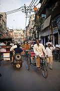 A man preddles his rickshaw on the streets of Chawri Bazaar, Old Delhi, India