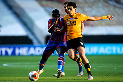 Raul Jimenez of Wolverhampton Wanderers takes on Mamadou Sakho of Crystal Palace - Mandatory by-line: Robbie Stephenson/JMP - 20/07/2020 - FOOTBALL - Molineux - Wolverhampton, England - Wolverhampton Wanderers v Crystal Palace - Premier League