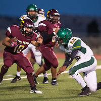 Mario Perez carries the ball for the Tohatchi Cougars in their game against the Thoreau Hawks Friday Oct. 5, 2018 in Tohachi.