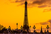 Art nouveau lamps on the Pont Alexandre III (bridge), with the Eiffel Tower behind, at sunset, Paris, France. The Pont Alexandre III is the most ornate bridge in Paris.
