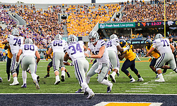 Sep 22, 2018; Morgantown, WV, USA; Kansas State Wildcats quarterback Skylar Thompson (10) hands the ball off to Kansas State Wildcats running back Alex Barnes (34) during the first quarter against the West Virginia Mountaineers at Mountaineer Field at Milan Puskar Stadium. Mandatory Credit: Ben Queen-USA TODAY Sports