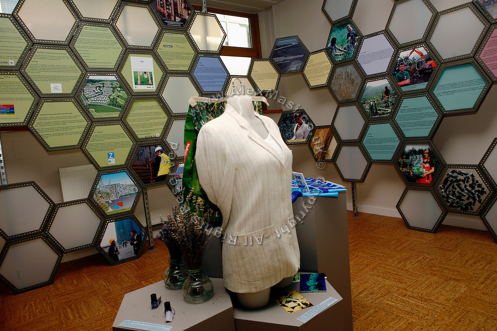 An exhibition about renewable energy and carbon emissions has been set up inside the offices of Bio Regional Development Group in the BedZED housing complex on Thursday, Sep. 6, 2007, in London, UK. BedZED or the Beddington Zero Energy Development, is an environmentally-friendly housing development near Wallington, England in the London Borough of Sutton. It was designed by the architect Bill Dunster who was looking for a more sustainable way of building housing in urban areas in partnership between the BioRegional Development Group and the Peabody Trust. There are 82 houses, 17 apartments and 1,405 square meters of work space were built between 2000. The project was shortlisted for the Stirling Prize in 2003. The project is designed to use only energy from renewable source generated on site. In addition to 777 square meters of solar panels, tree waste is used for heating and electricity. The houses face south to take advantage of solar gain, are triple glazed and have high thermal insulation while most rain water is collected and reused. Appliances are chosen to be water efficient and use recycled water wherever possible. Low impact building materials were selected from renewable or recycled sources and were all originating within a 35 mile radius of the site to minimize the energy required for transportation. Also, refuse collection facilities are designed to support recycling and the site encourage eco-friendly transport: electric and LPG cars have priority over petrol/diesel cars, and electricity is provided by parking spaces appositely built for charging electric cars.