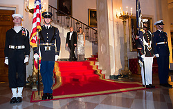 United States President Donald J. Trump and first lady Melania Trump precede President Emmanuel Macron and Mrs. Brigitte Macron of France to have photos taken during a visit to The White House in Washington, DC, April 24, 2018. Credit: Chris Kleponis / Pool via CNP