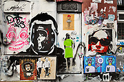 Graffiti & stencil art cover a building on Brick Lane, East London.
