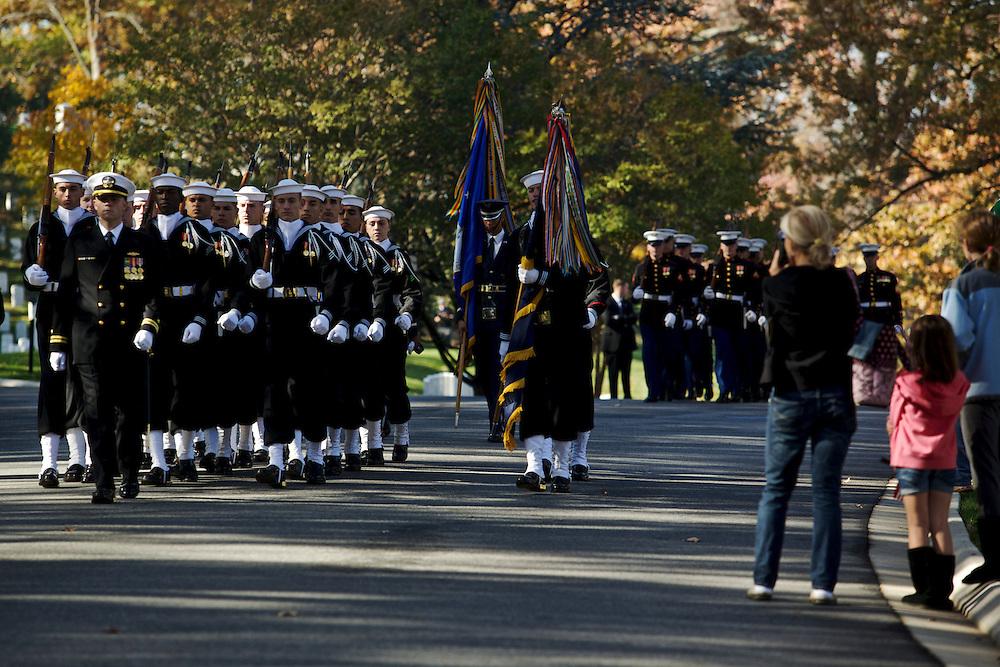 ARLINGTON, VA - NOVEMBER 11: Brooke Abbott, 7, of Virginia (R), watches as honor guards from each military branch make their way through Arlington National Cemetery on Veteran's Day November 11, 2012 in Arlington, Virginia.