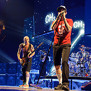 """WASHINGTON, DC -  May 8th, 2012 - Michael """"Flea"""" Balzary,  Anthony Kiedis and Chad Smith of the Red Hot Chili Peppers perform at the Verizon Center in Washington, D.C. The band was inducted into the Rock N Roll Hall Of Fame earlier this year and released their 10th studio album, I'm With You, in late 2011. (Photo by Kyle Gustafson/For The Washington Post)"""